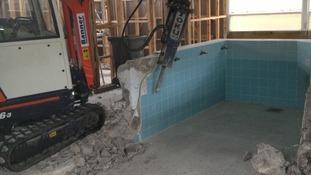 Demolition equipment begins work