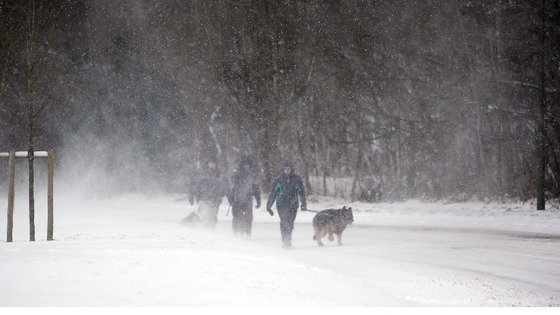 People walk in the snow near Bolney, West Sussex.