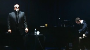 Billy Joel, accompanied by student Michael Pollack