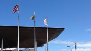 Red Dragon flag flying alongside the Union flag outside the Senedd