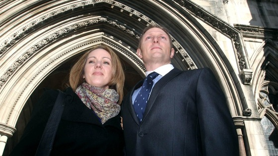 SAS sniper Sergeant Danny Nightingale with his wife Sally outside court today.