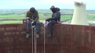 Protesters sat on top of a chimney