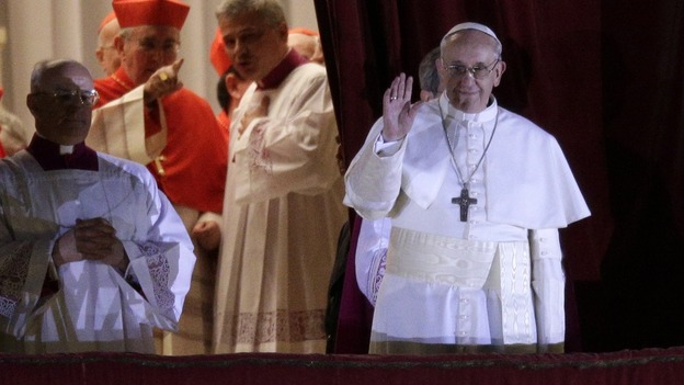 Cardinal Jorge Mario Bergoglio, who was elected as the new pope today, waves to the St Peter's Square crowd.