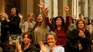 Worshippers cheer at the election of Argentine Cardinal Jorge Bergoglio as the new Pope