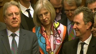 Theresa May looks on as Labour party leader Ed Miliband spoke during Prime Minister's Questions yesterday