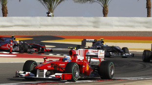 Ferrari driver Fernando Alonso of Spain leads a group of cars in the early stages of the Bahrain F1, 2010