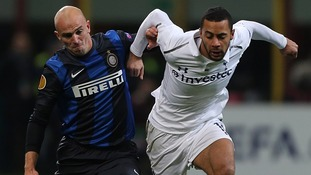 Mousa Dembele battles with Esteban Cambiasso at the San Siro
