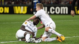 Lewis Holtby congratulates Emmanuel Adebayor for scoring the away goal