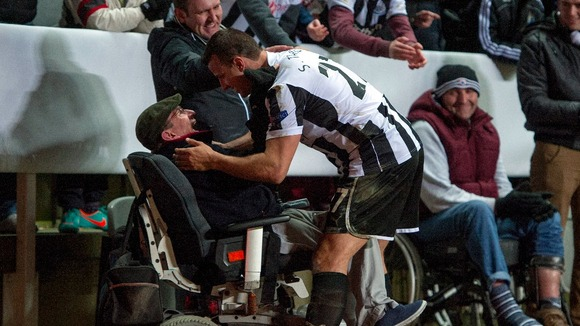 Newcastle United&#x27;s Steven Taylor celebrates with a fan after the final whistle