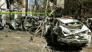 Damaged vehicles at the site of an explosion in Damascus last March