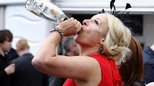 A racegoer on Ladies' Day during day two of the 2012 John Smith's Grand National meeting at Aintree Racecourse, Liverpool