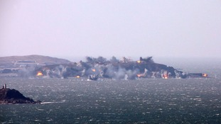 North Korea's artillery sub-units conduct a live shell firing drill