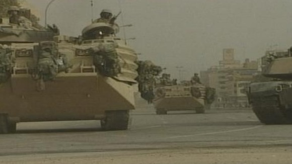 American troops arriving in Baghdad in April 2003