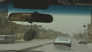 The team drove through the streets of Baghdad
