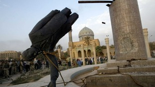 Saddam Hussein's statue is pulled down in central Baghdad