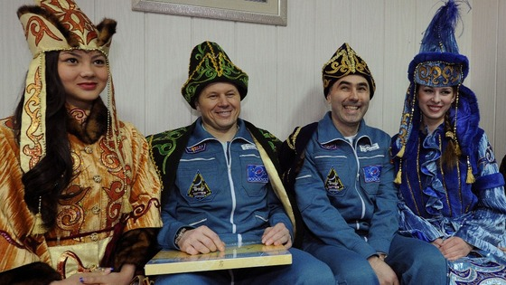Oleg Novitskiy and Evgeny Tarelkin dressed in Kazakh traditional clothing after touching back down on Earth
