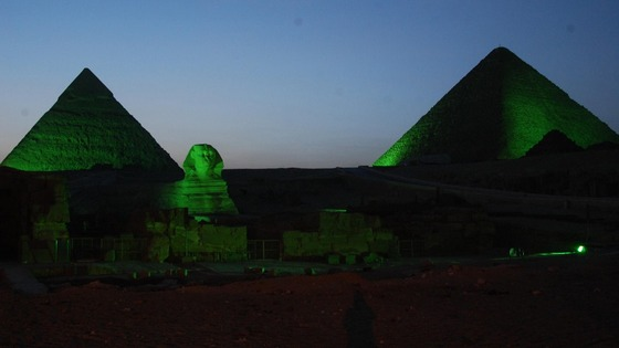 The pyramids and sphinx are among several landmarks illuminated in green for the celebration.