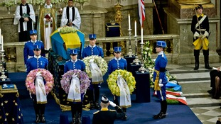Members of the Royal Guard hold wreaths in the Royal Chapel of the Royal Palace of Stockholm