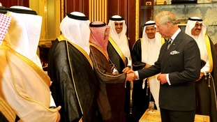 The Prince of Wales talks to members of parliament in the Shura parliament building