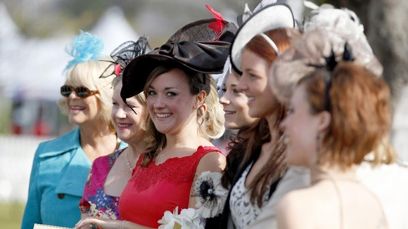 Aimee Fardell from Leicestershire (centre) arrives for Ladies Day with friends for her 'Hen Do'