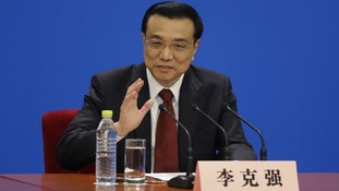 China's newly-elected Premier Li Keqiang speaks to the media during the National People's Congress.