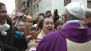 Newly elected Pope Francis greets crowds gathered in the Vatican