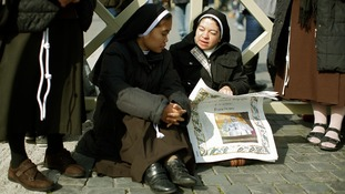Nuns await the blessing of newly elected Pope Francis in St Peter's Square