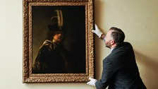 The Abbey's curator inspects the confirmed self-portrait.