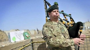 Pipe Major Scott pipes during the ceremony held in Afghanistan's 30C desert sun.