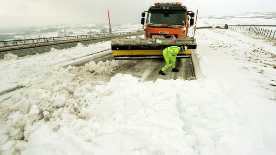 A snow plough clears the A66 near Bowes, County Durham