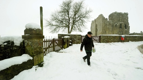 A man takes a walk through the grounds of Bowes Castle in County Durham