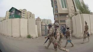Military patrols through central Baghdad