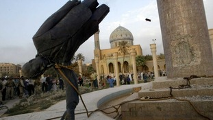 A statue of Saddam Hussein is pulled down in  central Baghdad in April 9, 2003.