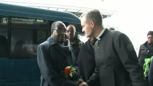 Mugabe is greeted at Rome airport