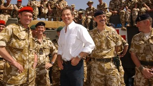 File photo of then Prime Minister Tony Blair meeting troops in the port of Umm Qasr. in March 2003