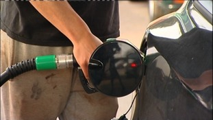 Man fills up his car with petrol