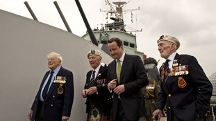Prime Minister David Cameron speaks with WWII veterans