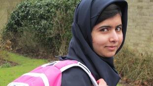 Malala Yousafzai with rucksack.