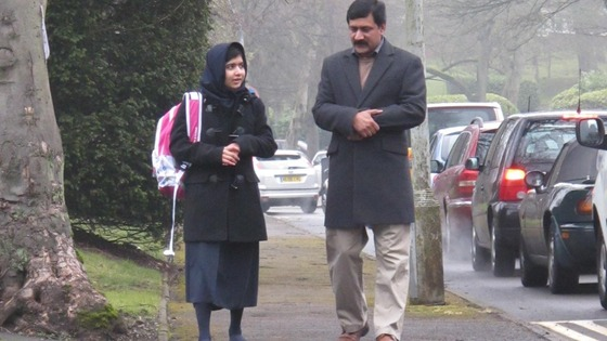Malala Yousafzai walks to school for the first time since she was attacked by the Taliban in October.
