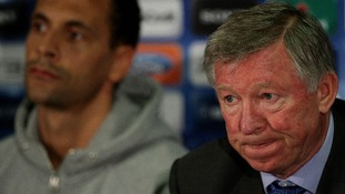 Manchester United's manager Sir Alex Ferguson (right) sits alongside Rio Ferdinand