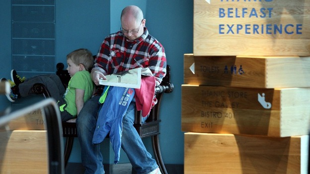 A man reads information about the Titanic, at the new Titanic Visitor centre in Belfast