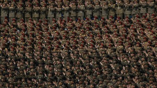 A crowd of military members clap hands at a stadium during a mass meeting of North Korea's ruling party in Pyongyang, North Korea.
