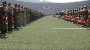 Military members attend a mass meeting called by the Central Committee of North Korea's ruling party.