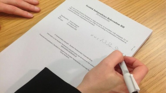 Scotland's Deputy First Minister Nicola Sturgeon signs the independence referendum Bill.