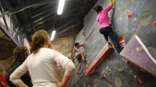 Climbers on a climbing wall.