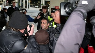 Michael Le Vell, arrives amongst a scrum of media at Manchester Crown Court