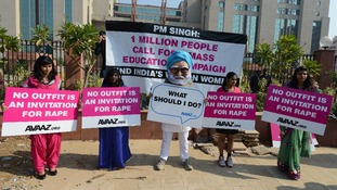 Demonstrators hold placards during an anti-rape protest outside a court in New Delhi.