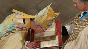 Rt Rev Justin Welby kisses the Canterbury Gospels during his enthronement service