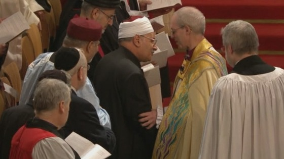 Archbishop of Canterbury Justin Welby shakes hands at his enthronement.