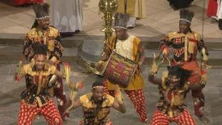 Dancers sing the African hymn An African hymn 'Gbeh Kpa Kpa Ba' - or 'A New Beginning'.